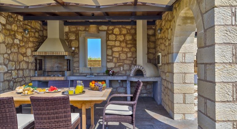 BBQ area with pizza oven and dining area