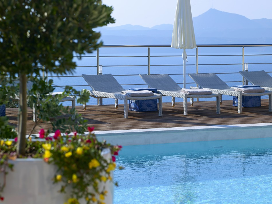 Colourful flowers and sunbeds complement the pool
