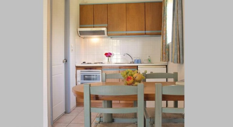 Kitchen and dining area in two bedroom apartment