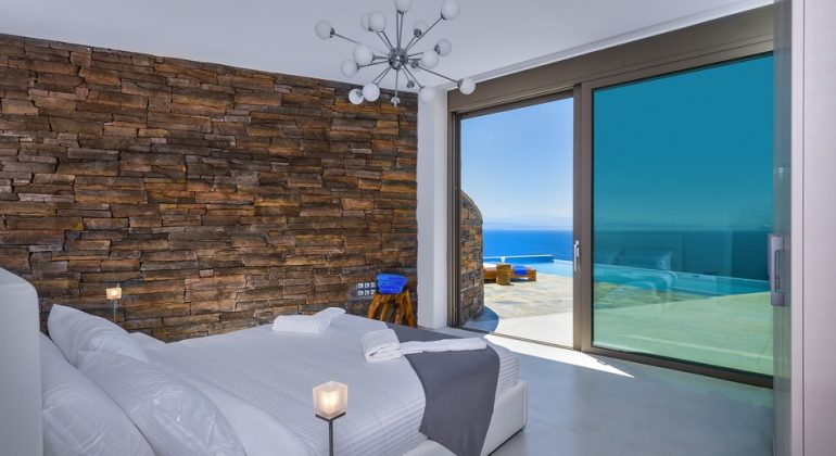 Seafront master bedroom with direct access to pool terrace