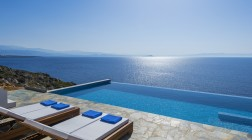The infinity pool blends with the sea offering glorious views
