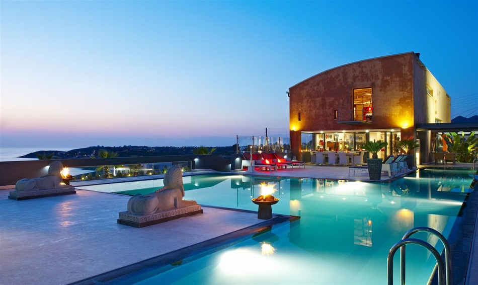 Villa and pool at dusk