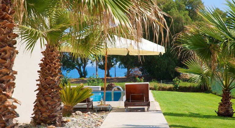 Landscaped gardens surround the pool