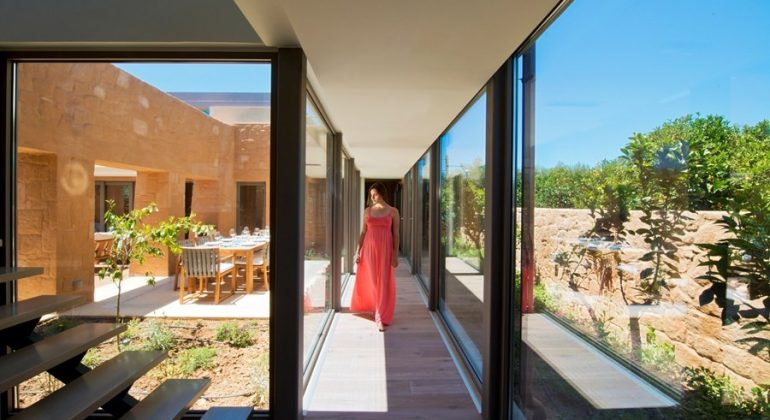 Transparent corridor that allows guests to walk through nature...