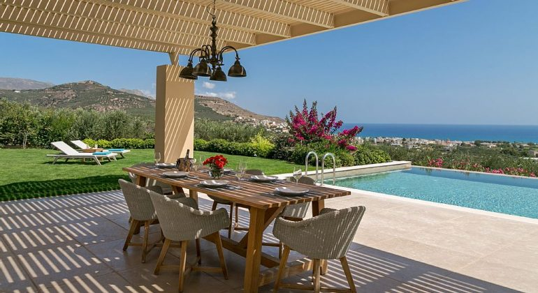 Pergola covered dining area by the pool