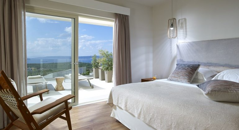 Double bedroom with balcony and views