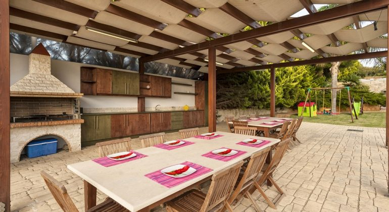 Pergola covered BBQ and dining area