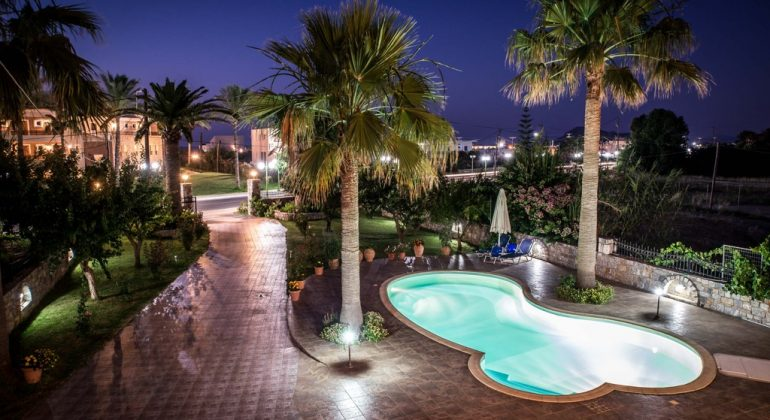 Pool and gardens at night