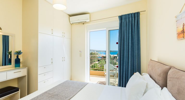 A twin bedroom with private balcony