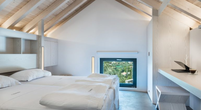 Twin bedroom with beamed ceiling
